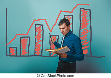 businessman showing a man holding a book on a graph business gro