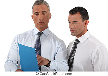 businessman showing a report to a colleague