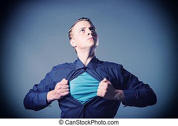 Businessman showing a superhero suit underneath his suit