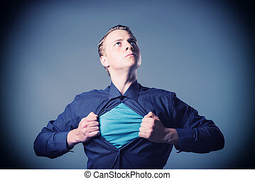 Businessman showing a superhero suit underneath his suit