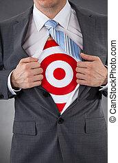Businessman Showing A Target Under Shirt