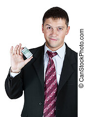 Businessman showing a wad of money