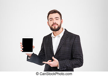 Businessman showing blank tablet computer screen