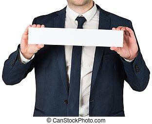 Businessman showing card to camera