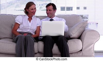 Businessman showing colleague somet