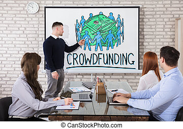 Businessman Showing Crowd Funding Concept In Office