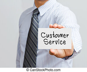 Businessman showing customer service word on white card