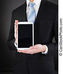 Businessman Showing Digital Tablet