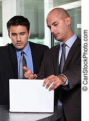 Businessman showing his associate a report