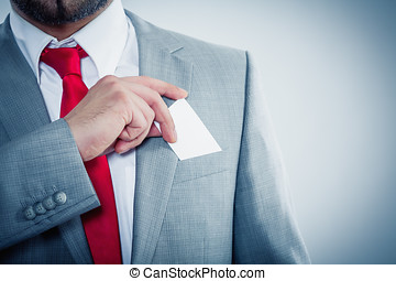 Businessman showing his business card copyspace available