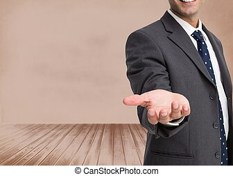 Businessman showing his empty hand - Composite image of...