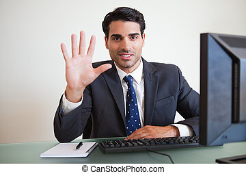 Businessman showing his hand