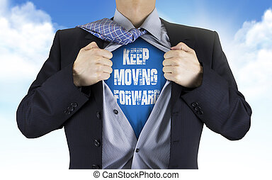 businessman showing Keep moving forward words underneath his...