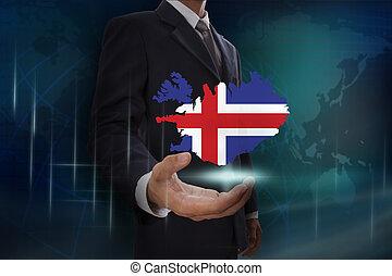 Businessman showing map of Iceland on globe background