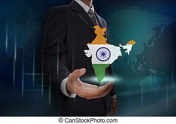 Businessman showing map of India on globe background