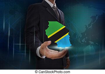 Businessman showing map of Tanzania on globe background