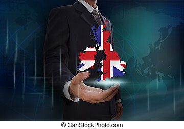 Businessman showing map of United Kingdom on globe background