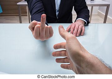 Businessman Showing Middle Finger To His Partner