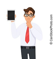 Businessman showing new tablet computer and asking silence. Shut up! Keep quiet! Person is keeping finger on lips. Male character illustration. Modern technology concept in vector cartoon style.