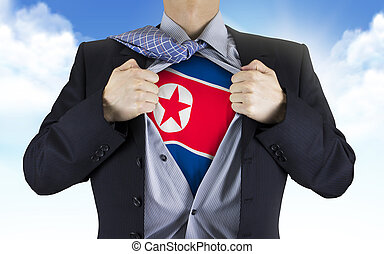 businessman showing North Korea flag underneath his shirt...