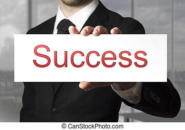 businessman showing sign success