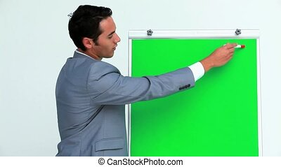 Businessman showing something on a board with croma key in...