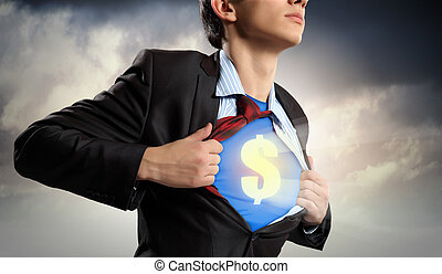 Businessman showing superman suit underneath shirt - Image...