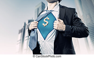 Image of young businessman in superhero suit with dollar sign on chest