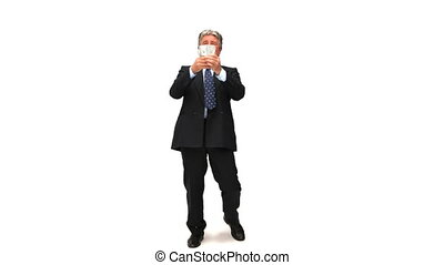 Businessman showing the money that he earned