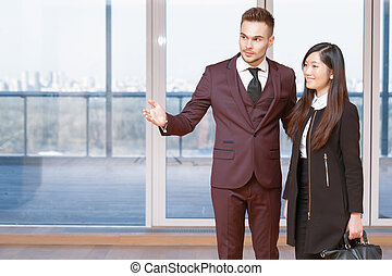 Businessman showing the office to his partner