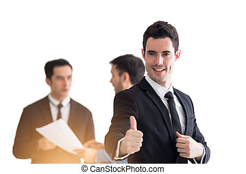 Businessman showing thumbs up in the office