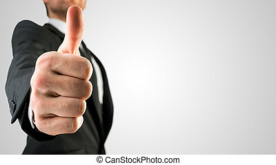 Businessman Showing Thumbs Up Sign in Close Up