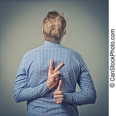 businessman showing two fingers behind his back