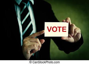 Businessman showing vote card