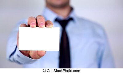 businessman presenting and showing your text or product on white placard isolated on white background. Proud man indicate on white placard and looking at camera.