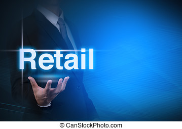 businessman showing word RETAIL - businessman with Retail...