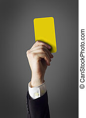 businessman showing yellow card
