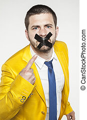 businessman shows his sealed lips, a conspiracy of silence
