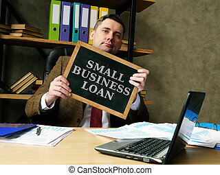 Businessman shows phrase small business loan.