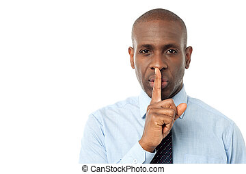 Businessman shows silence gesture - Corporate man with...