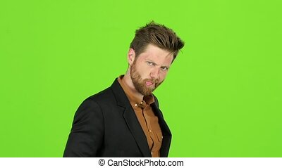 Businessman shows the language to others. Green screen. Slow motion