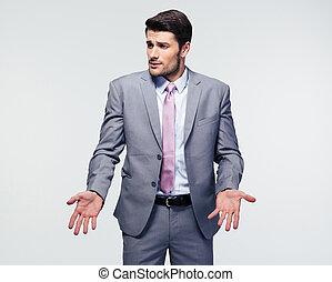 Businessman shrugging shoulders