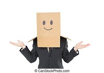 Businessman shrugging with box on head