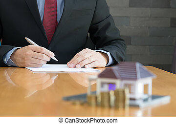 Businessman signing a contract for real estate investing