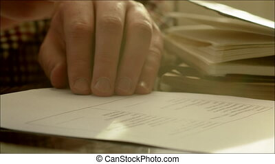 Businessman Signing Two Copies of Contract