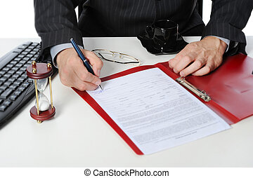 Businessman signs a contract.