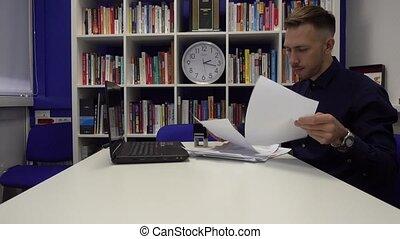 Businessman signs a document