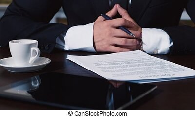 Businessman signs a number of document