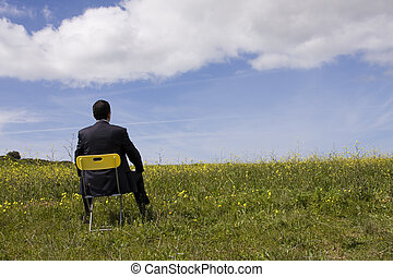 Businessman sit in a yellow chair