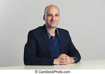 businessman sits at the desk